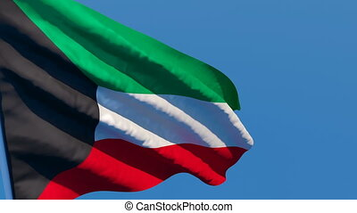 The national flag of Kuwait is flying in the wind