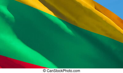 The national flag of Lithuania is flying in the wind