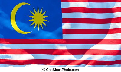 The national flag of Malaysia is flying in the wind.