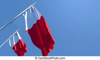 The national flag of Malta flutters in the wind