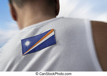 The national flag of Marshall Islands on the athlete's back.