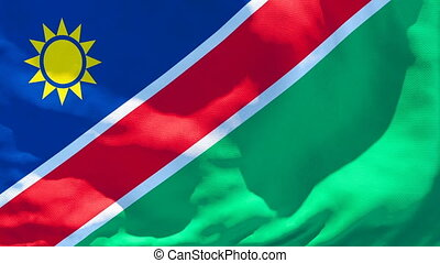 The national flag of Namibia flutters in the wind.