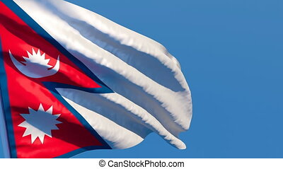 The national flag of Nepal flutters in the wind against a ...