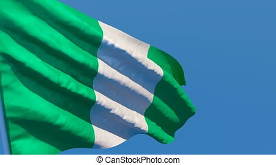 The national flag of Nigeria is flying in the wind
