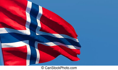 The national flag of Norway flutters in the wind against a ...