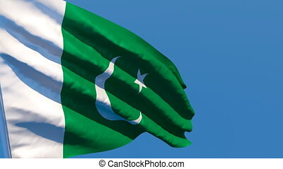 The national flag of Pakistan flutters in the wind against a...