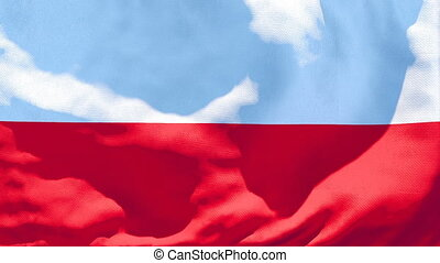 The national flag of Poland is flying in the wind.