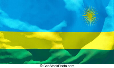 The national flag of Rwanda flutters in the wind.