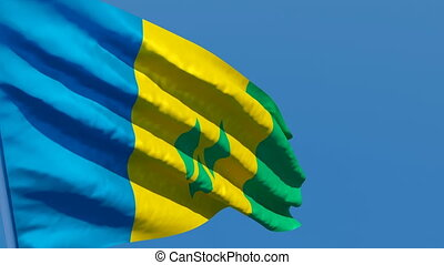 The national flag of Saint Vincent and the Grenadines ...