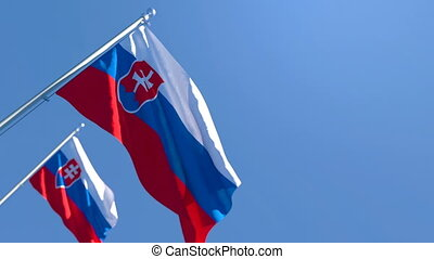 The national flag of Slovakia flutters in the wind against a blue sky