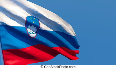 The national flag of Slovenia flutters in the wind against a...