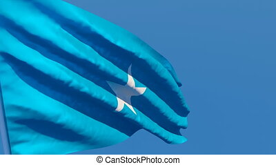 The national flag of Somalia flutters in the wind against a ...
