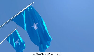 The national flag of Somalia flutters in the wind against a blue sky