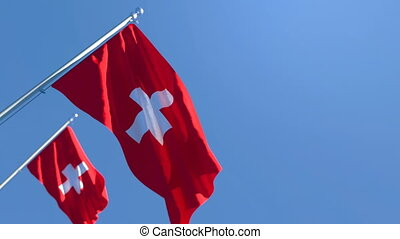 The national flag of Switzerland flutters in the wind