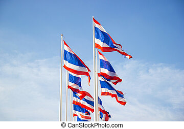 The National Flag Of Thailand with blue sky background