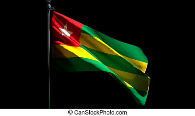 The national flag of Togo flutters in the wind against a black background.
