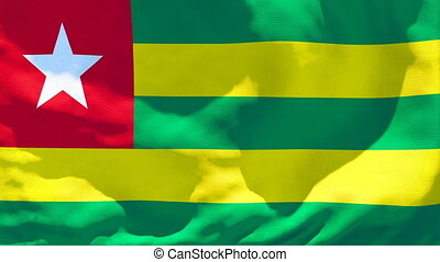 The national flag of Togo flutters in the wind.