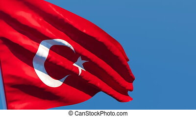 The national flag of Turkish flutters in the wind against a ...