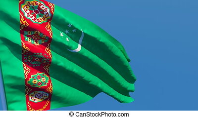 The national flag of Turkmenistan flutters in the wind ...