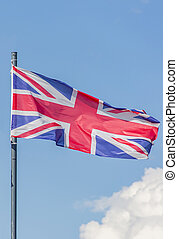 The National flag of United Kingdom flay over the blue sky