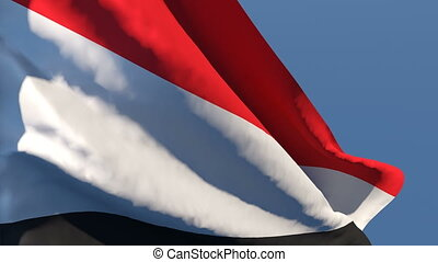 The national flag of Yemen flutters in the wind