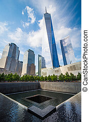 The National September 11th Memorial and 1 World Trade Center in Lower Manhattan, New York.