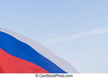 The national symbol - the flag of Russia waving in the wind against the sky. Day of the flag of the Russian Federation