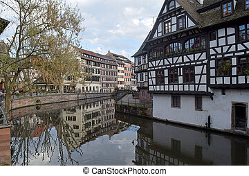 """March 28, 2017-Strasbourg-Alsace-France-A view of the typical ancient village called """"Petite France"""" in Strasbourg destination for many tourists because of its bridges and its half-timbered houses"""
