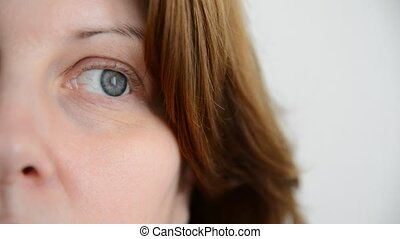 The nervous tic of lower eyelid in a woman - The nervous tic...