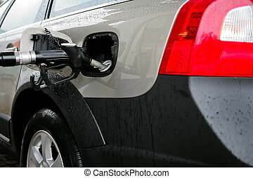 car on a filling station - The new car on a filling station