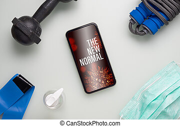 The New Normal healthy and fitness during quarantine times in Coronavirus Covid-19 pandemic outbreak background concept. Mockup mobile phone for fit and workout at Home, Be Active during virus pandemic.