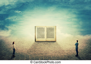 Surreal view as a boy and girl students stand on a pavement road in front of a giant opened book. The importance of reading in the modern world. Education concept.