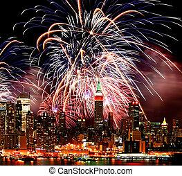 The New York City skyline and fireworks - The New York City...