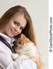 The nice girl with a red cat on hands - The young nice girl...