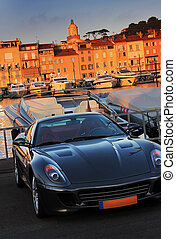 saint tropez - the nice sporting car in front of the houses...