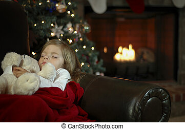 A little girl sleeps in anticipation for Christmas.