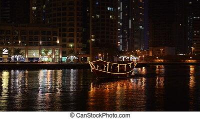 Dhow boat - The night illumination of Dubai Marina and Dhow...