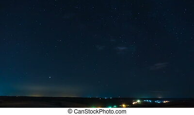 The nighttime time lapse, the starry sky, the movement of...