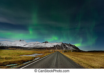 The Northern Light at the mountain in Iceland. Amazing Aurora Borealis