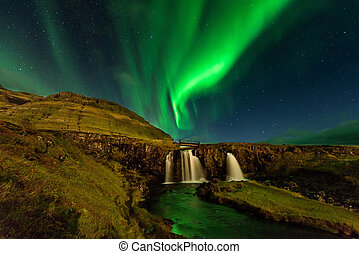 Amazing landscape with green bands of Aurora Borealis. Snaefellnes, Iceland