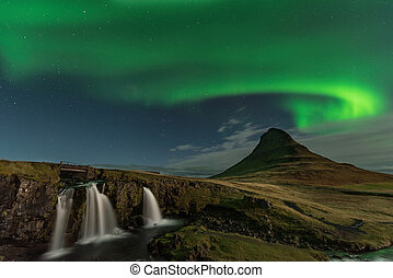 The Northern Light at the mountain Kirkjufell Iceland