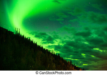 The Northern Lights Shine Up over a Mountainside near Valdez...