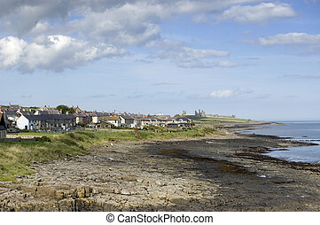 Craster - The Northumbrian village of Craster with the ruins...