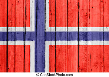 The Norwegian flag painted on a wooden fence