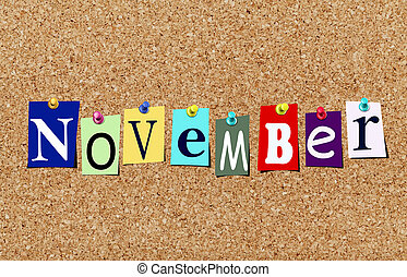 The november magazine cutout letters pinned to cork noticeboard