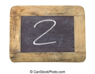 """The number """"2"""" written with white on a blackboard"""