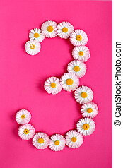 The number 3 is written in white pink flowers on a bright pink background