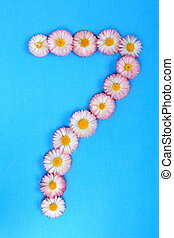 The number 7 is written in white pink flowers on a blue background.