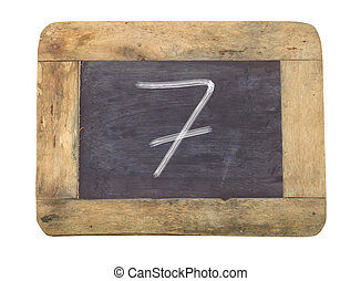 """The number """"7"""" written with white on a blackboard"""