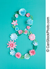 The number 8 is made of flowers cut from paper on a mint background